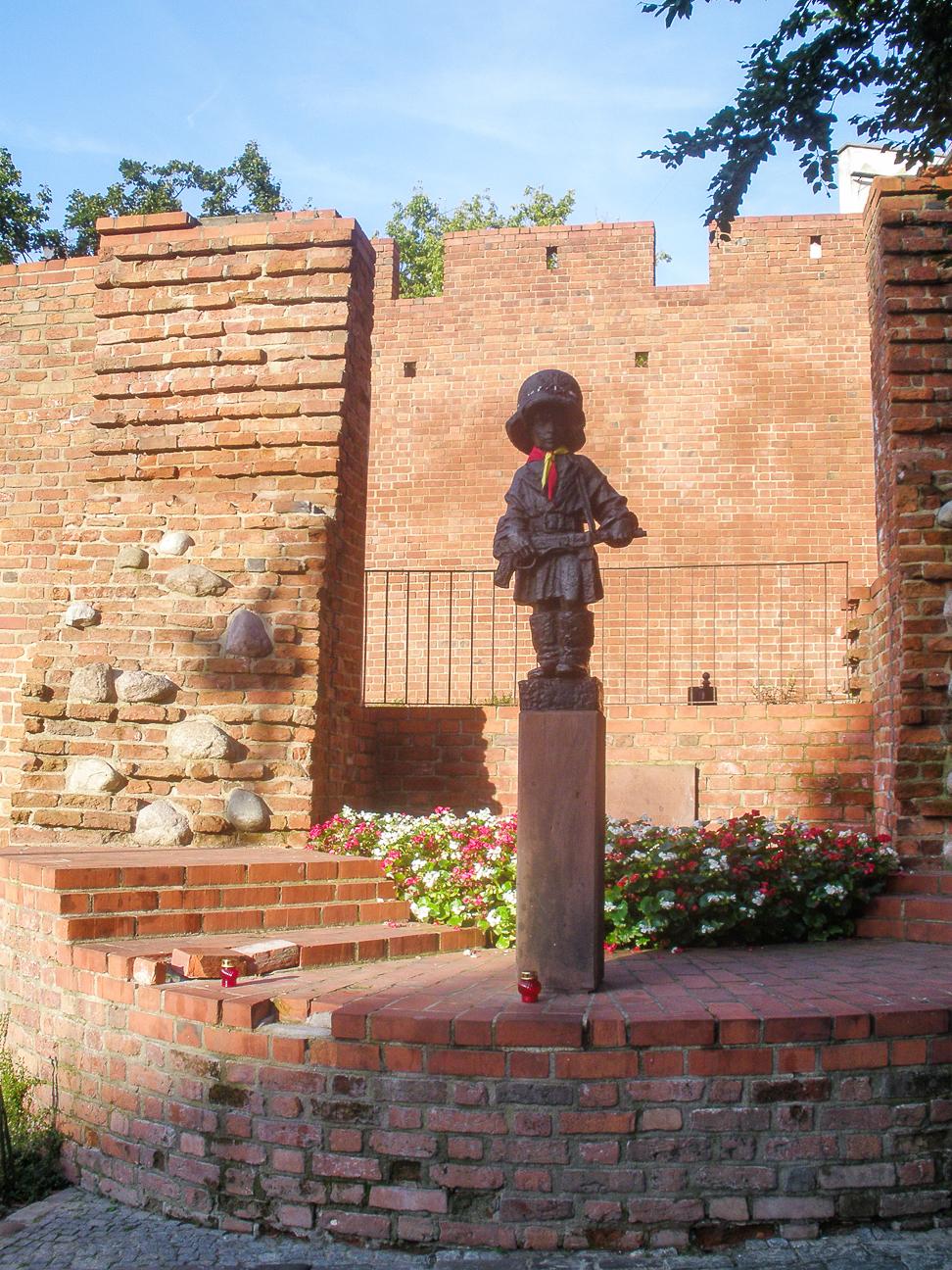 Que ver en Varsovia Estatua de Maly Postaniec